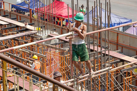 45271239-burmese-man-is-working-at-the-new-building-in-downtown-yangon-myanmar-yangon-also-known-as-rangoon-i